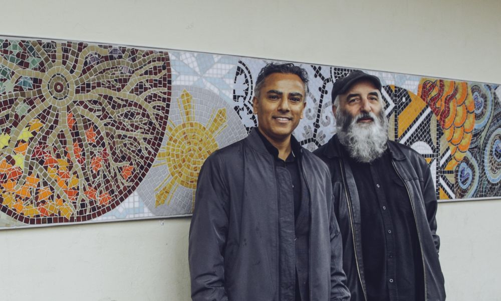 Sunset on Fraser Business Association executive director Rob Nijjar (L) and artist Bruce Walther (R) stand in front of the new Sunset on Fraser mosaic. Photo credits: Alfonso Arnold