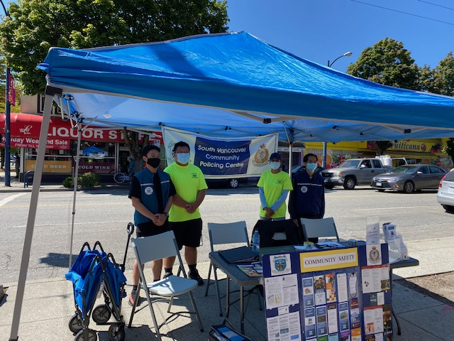 Volunteers from the local Community Policing Centre spend the afternoon providing information to Sunset on Fraser shoppers