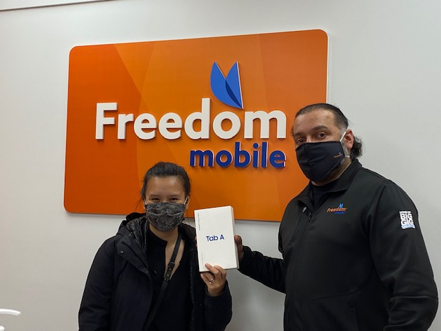 Sylvia receives her wonderful prize – a Samsung tablet – from co-owner Shaun.